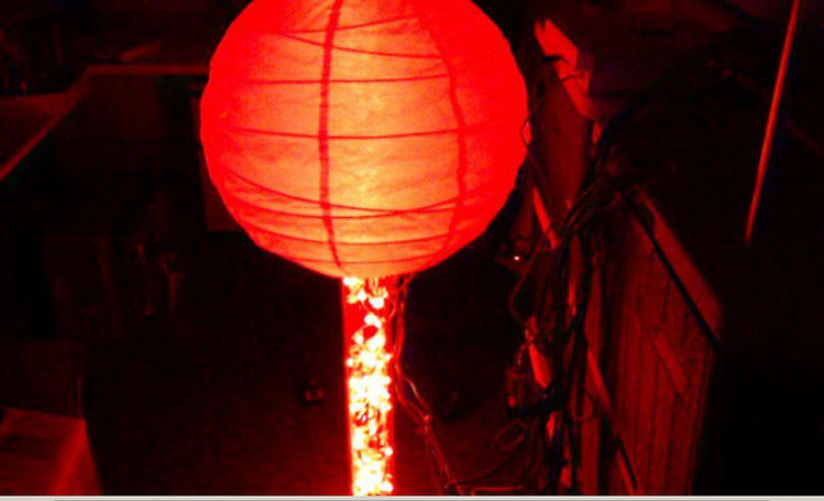 """A """"fire gate"""" created with a paper lantern and red LEDs."""