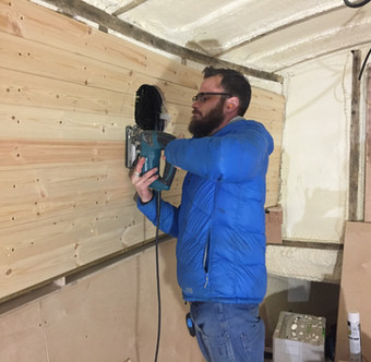 Cutting the wall away to reveal the porthole template hidden behind.
