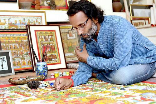 Kalyan Joshi painting his artwork.jpg