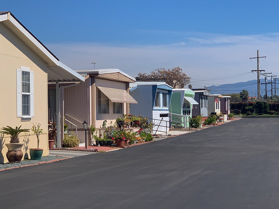View of row of mobile homes in trailer p