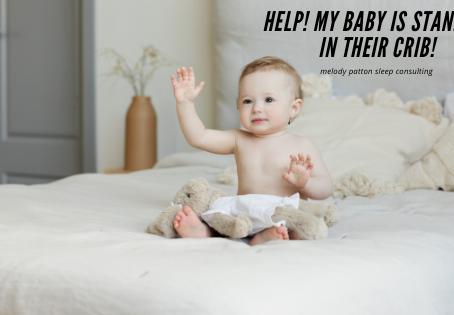 Help! My baby is standing in their crib!