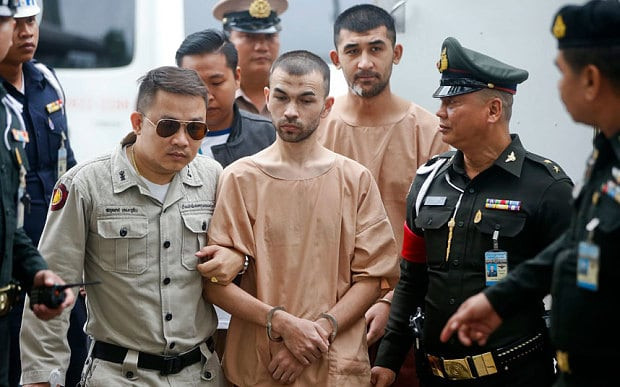 Adem Karadag (C, front), and Yusufu Mieraili (C-R, back) are escorted by officers and prison personnel to the Military Court, in Bangkok, Thailand Photo: EPA/DIEGO AZUBEL