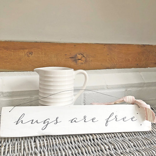 Hand painted wood sign - Hugs are free