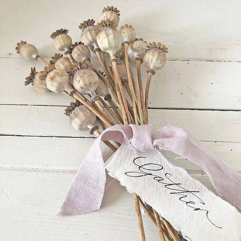 Dried poppy bunch with calligraphy tag