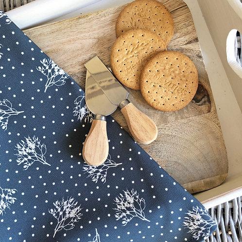 Pretty Christmas mistletoe & snow tea towel. Available in four colours