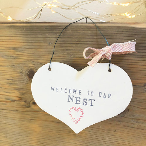Hanging heart wood sign for your home - welcome to our nest