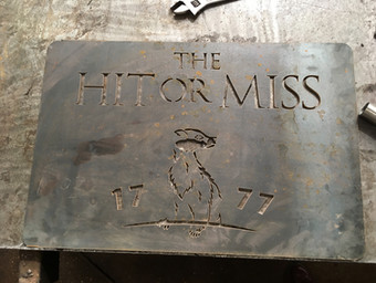 The Hit or Miss pub waterjet cut sign