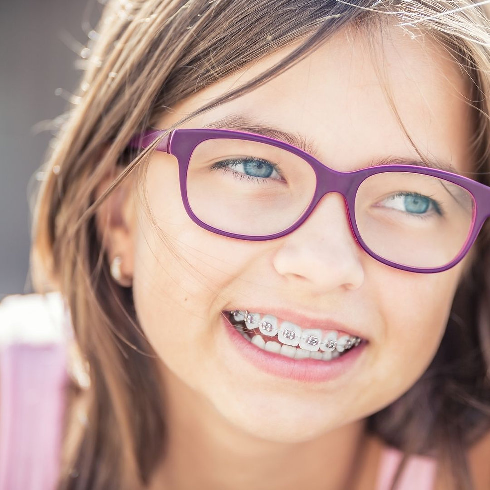 young child wearing braces in Rochester NY