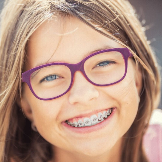 female child with braces on