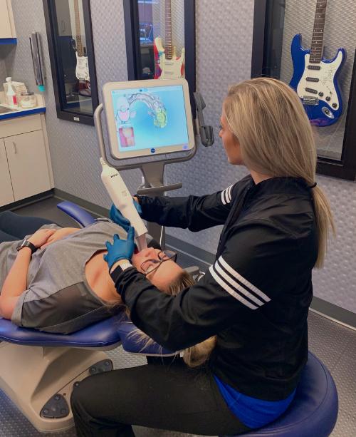 An Orthodontist analyzing straight teeth