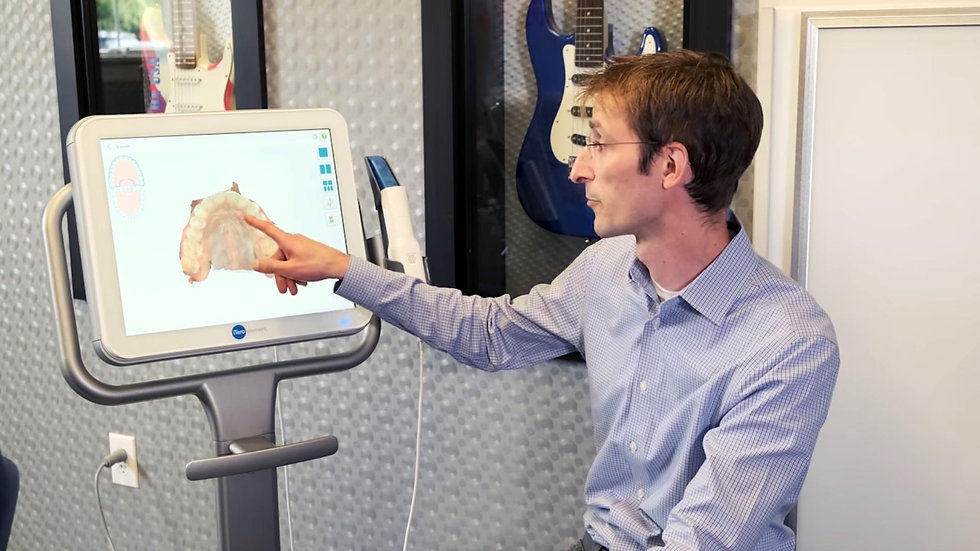 An Orthodontist explaining Invisalign