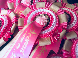 Breast in show rosettes