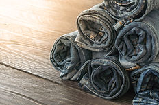 stacks-of-jeans-clothing-on-wood.jpg