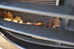 Porsche 911 radiator grill with leaves in the radiator