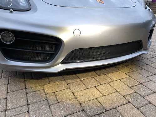 Side view of GT silver Porsche Cayman 981