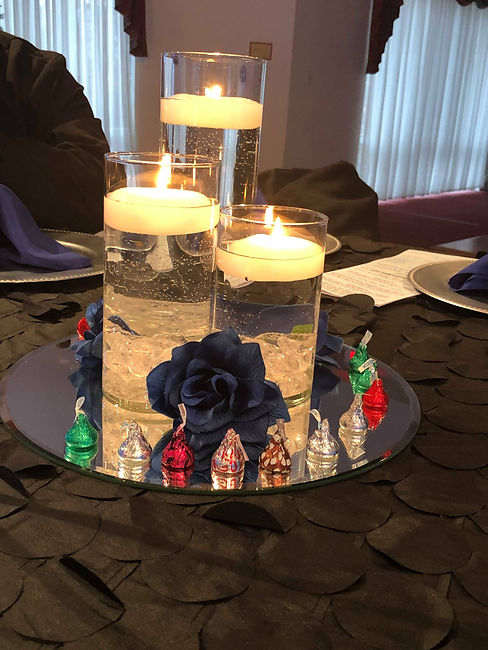 Dinner table set with floating candles and flowers