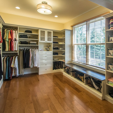 Walk-In Closet with Antique White Cabinetry