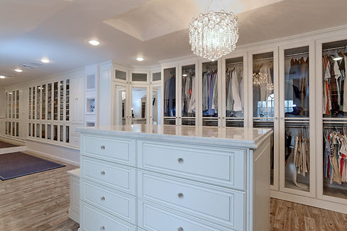 Dressing room with glass door closets and center island