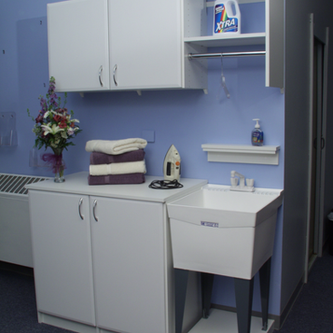 Laundry with Cabinets for Storage and Counter for Folding