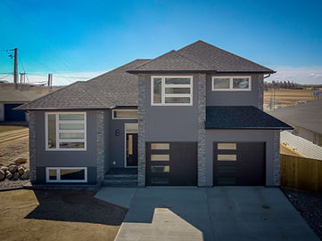 Beautiful home with many custom features.  Take a Virtual Tour and walk through this home or view the gallery of images below.  Give us a call to see how we can make your dream home a reality!