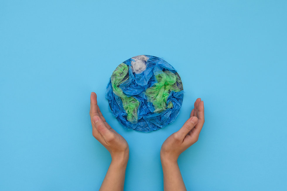 Hands holding planet Earth made from pla