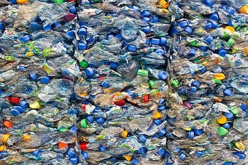 Large stack of old plastic bottles.jpg