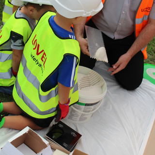 Lovells helped children learn how to tile