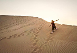 Sandboarding the dunes in Abu Dhabi