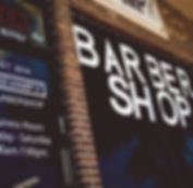 The storefront of the famous Revamp Barbershop