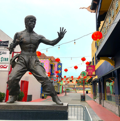 ToCo Haus sign behind the Bruce Lee Statue