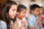 girl praying in Children's Department