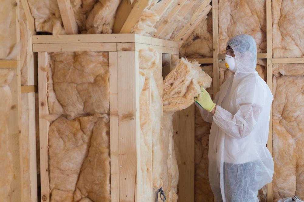 Worker putting in insulation