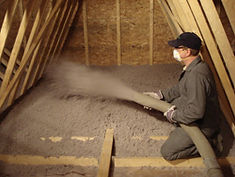Spraying Cellulose Insulation in Attic