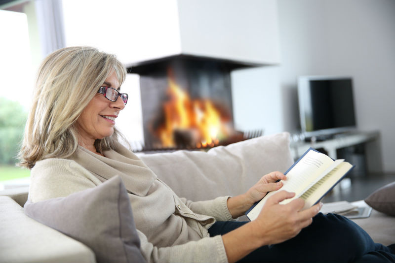 Happy woman reading at home