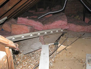 Removing Insulation from Attic