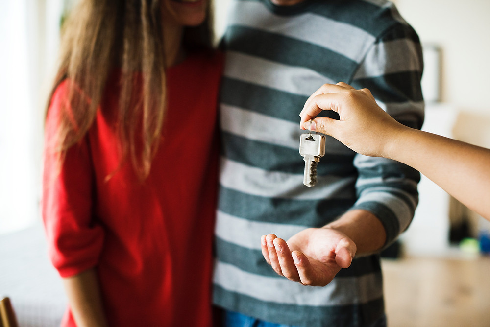 A couple getting the keys to their new house