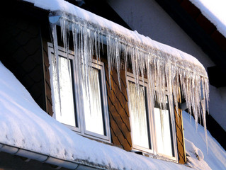How Insulation Can Help Prevent Ice Damage on Your Roof This Winter