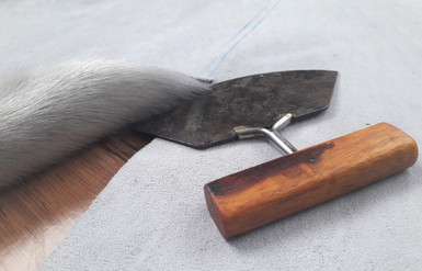 Traditional Ulu knife cut by Oïjha Couture