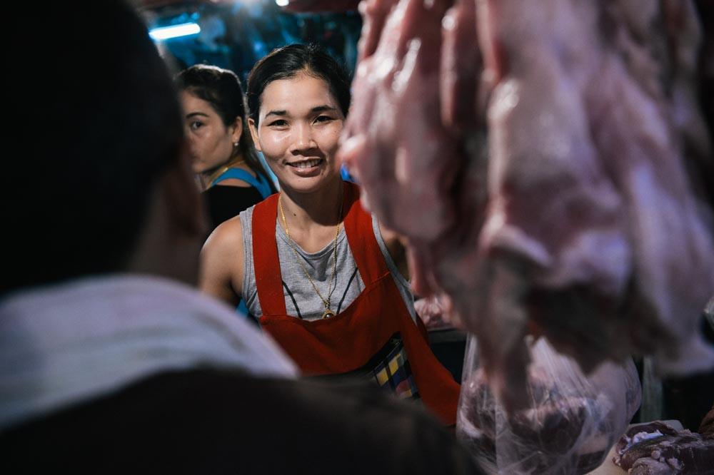 Woman butcher at Khlong Toei market