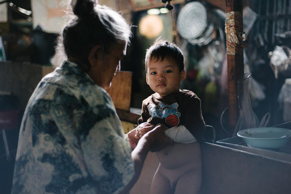Grandmother and her grandchild at Khlon Toei Bangkok