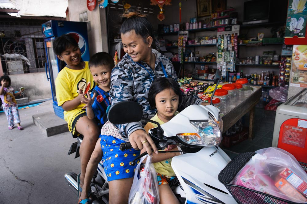 Woman and 3 children on a single motorbike