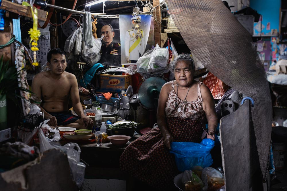 Old woman and her son having their lunch at Khlong Toei Bangkok