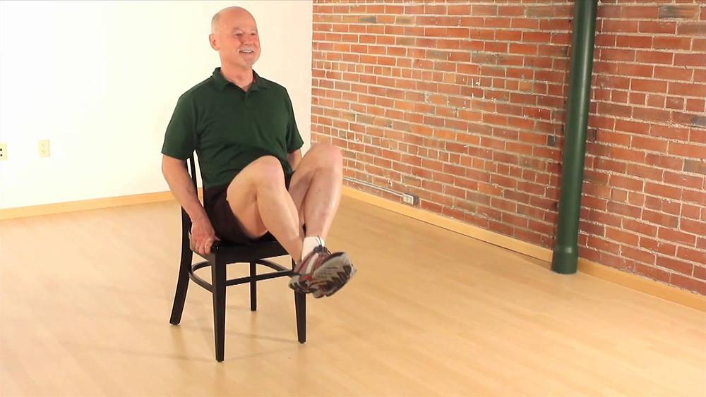 man doing chair crunches