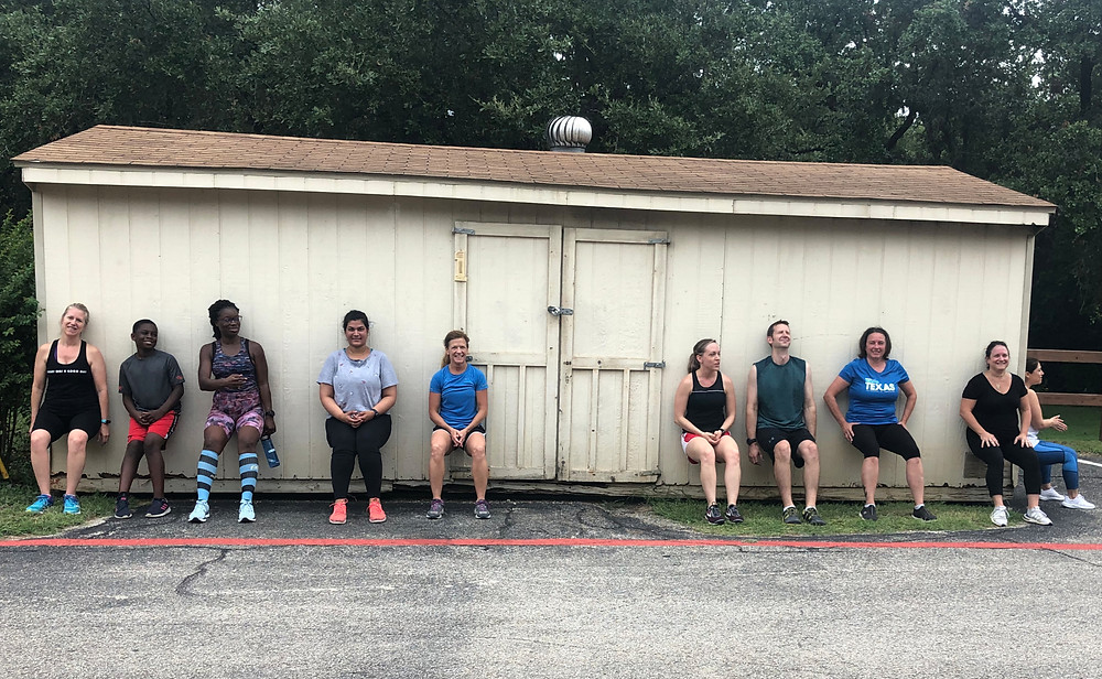 fitness students doing wall sit