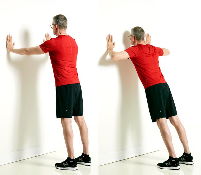man doing wall push-up