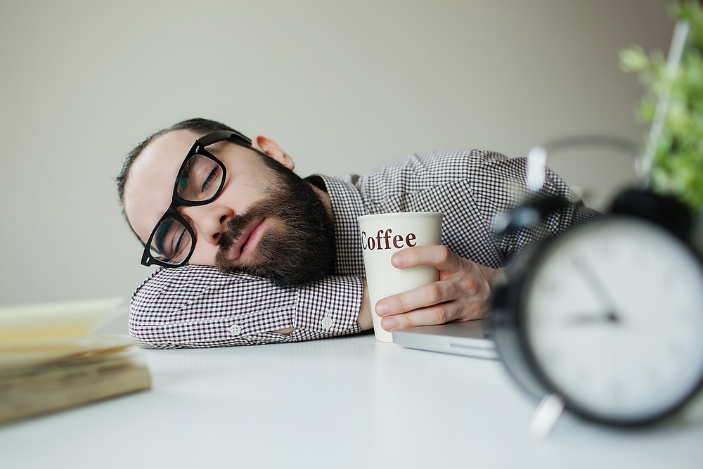 person sleeping with coffee