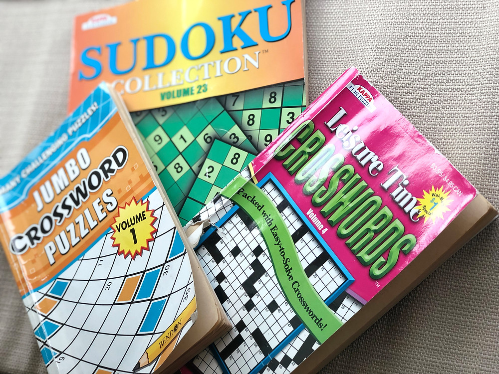 stack of Sudoku and crossword puzzles