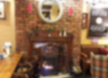 The Lindisfarne Inn bar and lounge with a blazing fire at Holy Island Northumberland