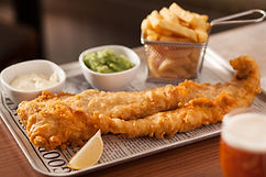 Eating out, pub food Craster Arms, Beadnell. Northumberland. Fish and Chips. Catch of the day. Mushy peas