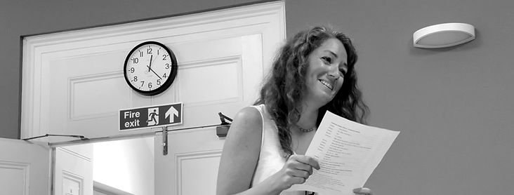 Woman smiling and holding a play script